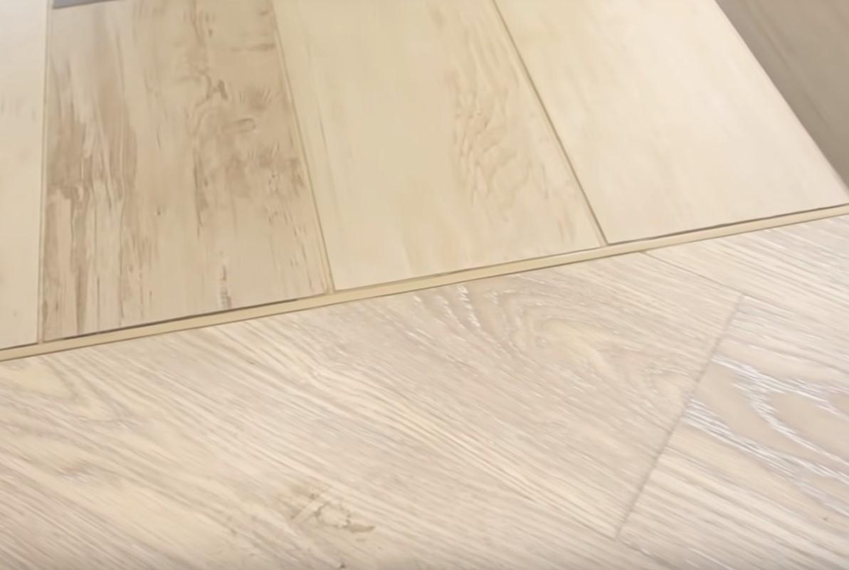 Заделка стыка ламината и плитки пробковым компенсатором